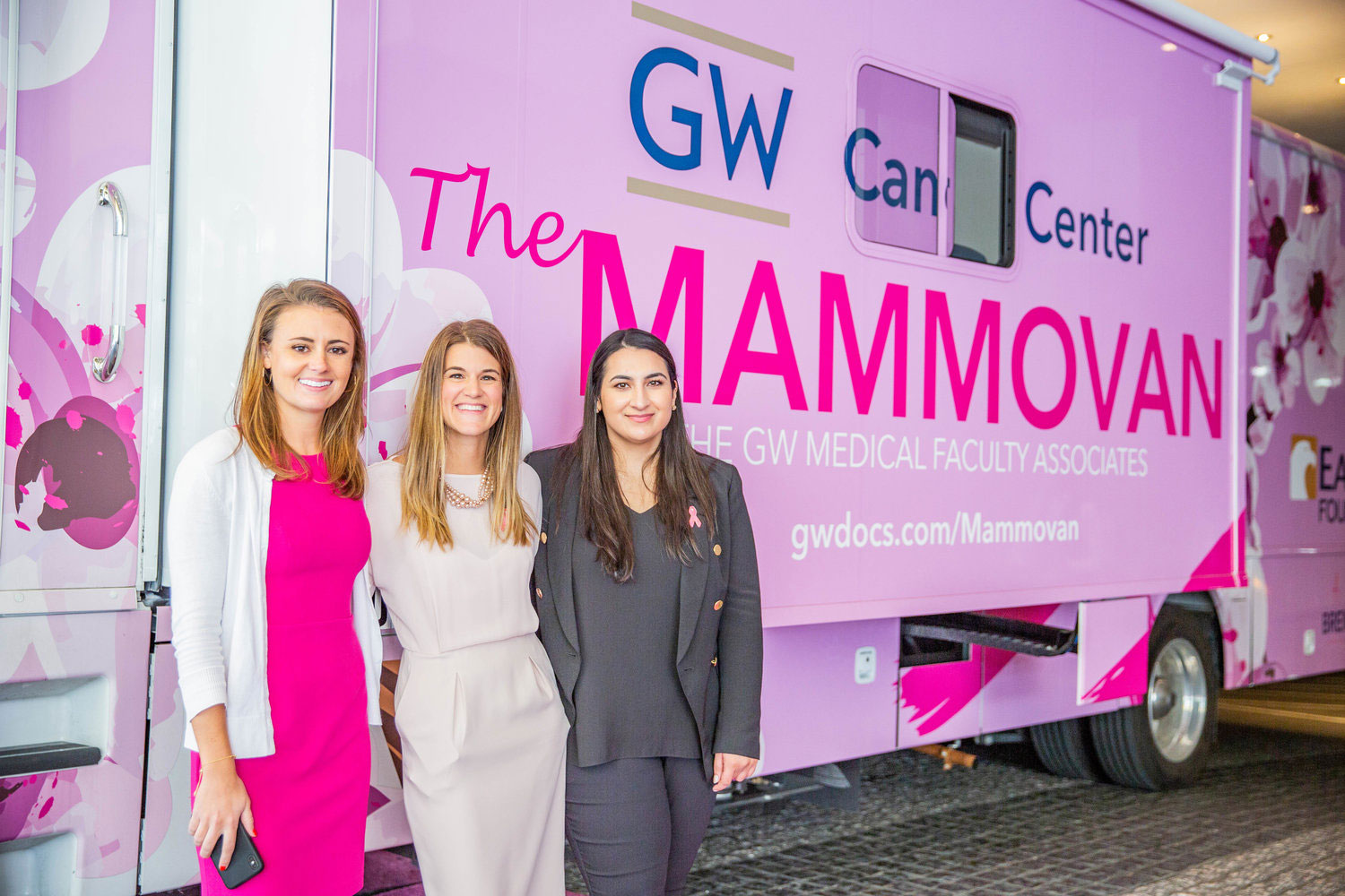 three women standing in front of mammovan